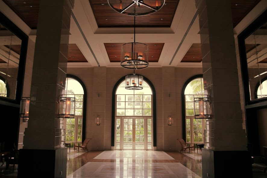 The high ceilings of the reception and hall are filled with marble and feel very grand
