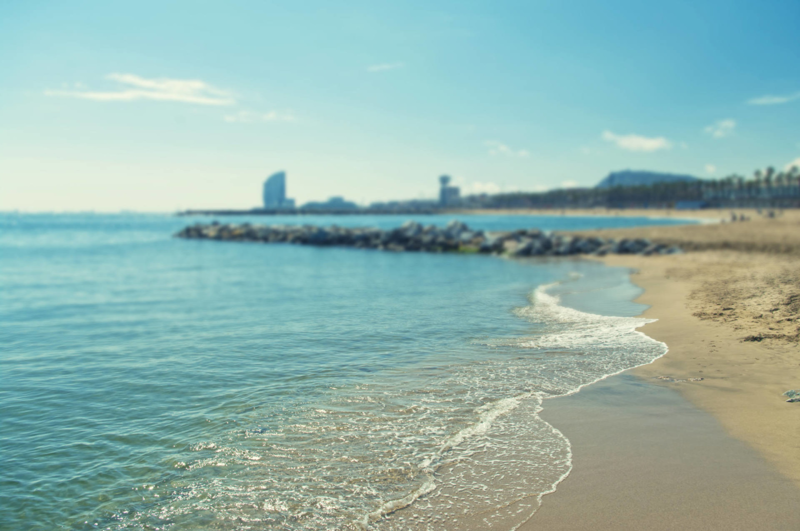 cross-processed background image of Barcelona beach on sunny spring day with shallow depth of field, Spain