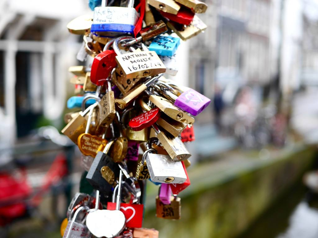 Padlocks on the love lock bridge in Amsterdam. One of the most Instagrammable places in Amsterdam.