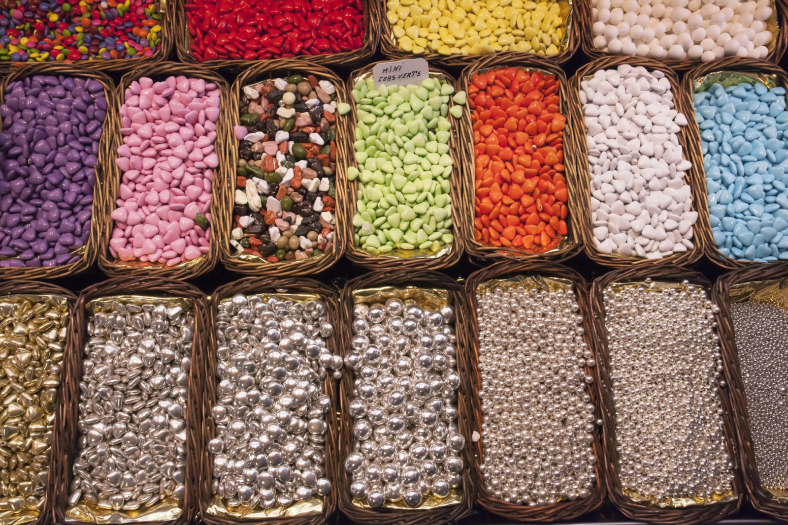 sweets, jelly beans of different colors, in baskets on the shelves, Spain