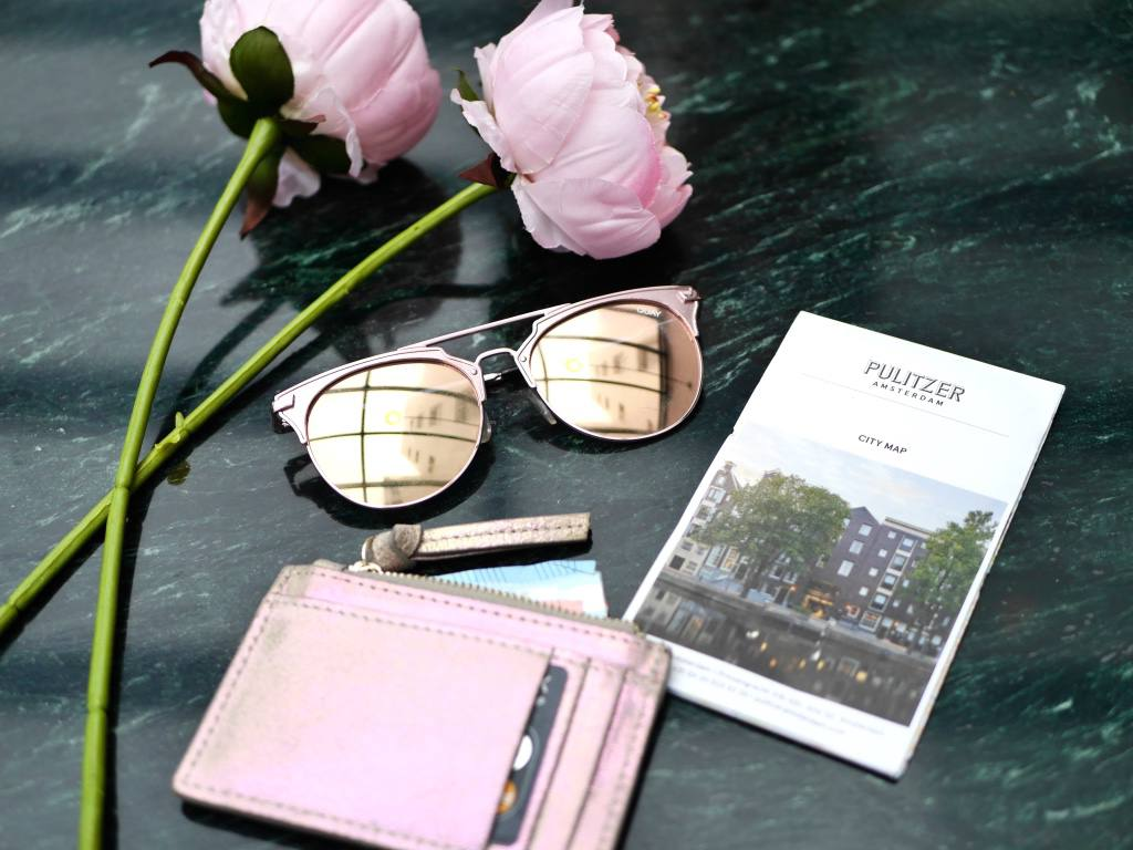 rose-gold-flatlay-travel-accessories