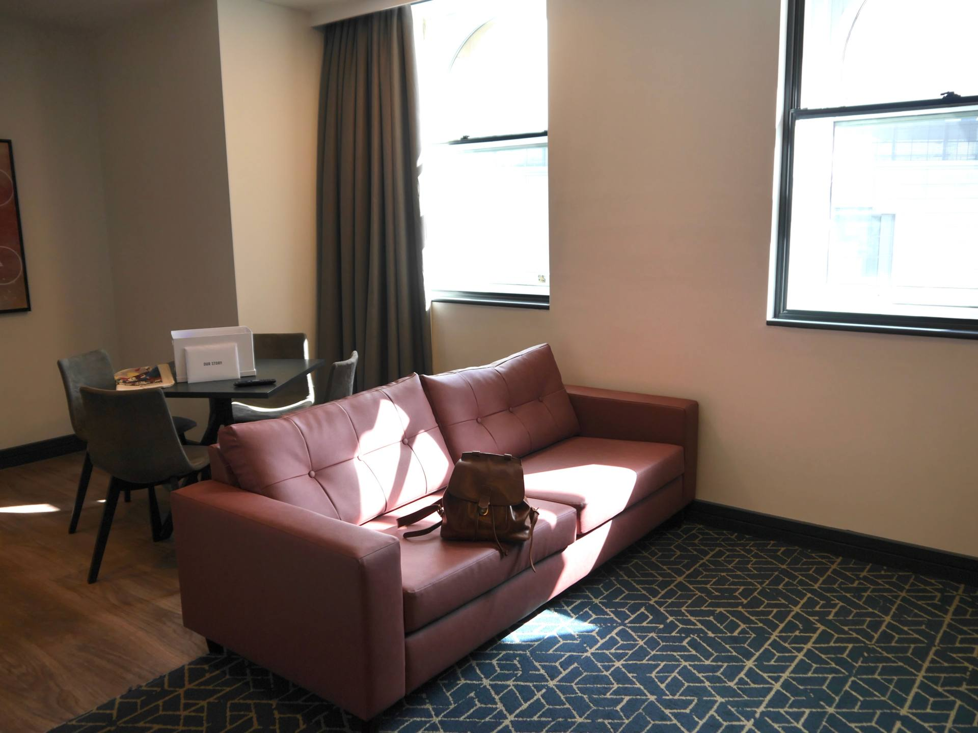 Living room of Liberty Suite at Roomzzz Manchester Corn Exchange