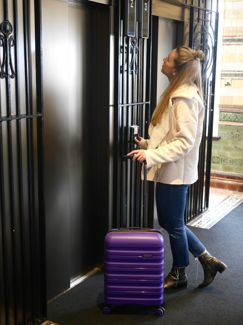 The Travelista in Lift at Roomzzz Manchester Corn Exchange
