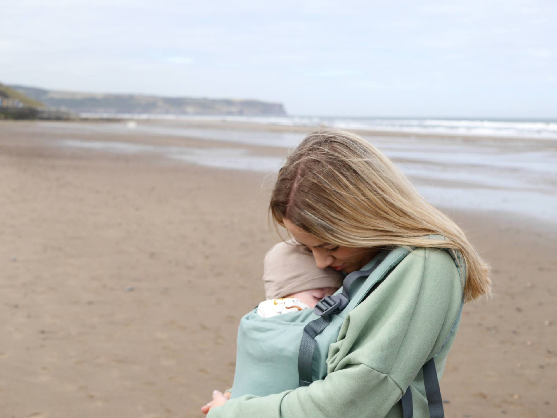 Mother and baby on Whitby beach
